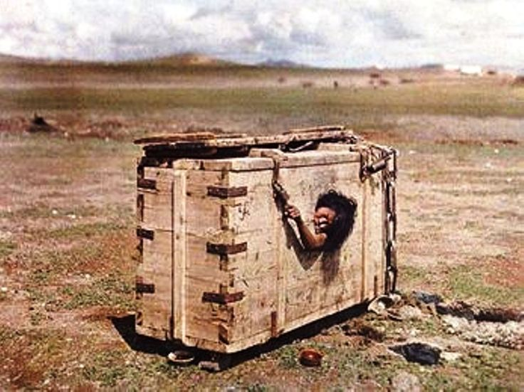 A Mongolian woman condemned to death is seen from the porthole of a crate inside which she is encumbered and left to die of starvation, victim of the Stalinist repressions in Mongolia.