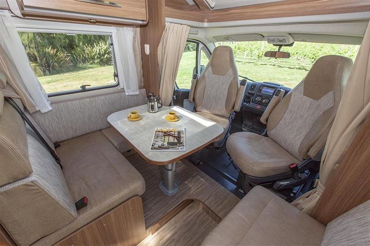 Inside a luxury campervan: Swivelling front seat maximises space in dinette. Feel free to use this image but give credit to http://smartrv.co.nz/motorhomes-for-sale