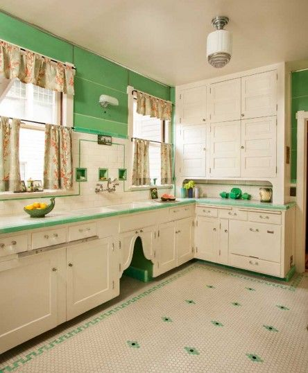 Restored 1910 kitchen ...the tile floor dates to the 1930 renovation; cabinets are likely original. Nancy Conescu added the arched doors. Glossy green Marlite on the walls is ca. 1951.