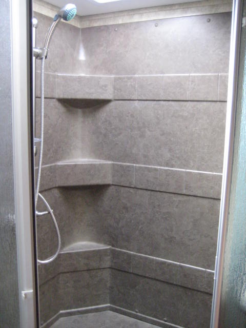 large shower surround with detachable shower head
