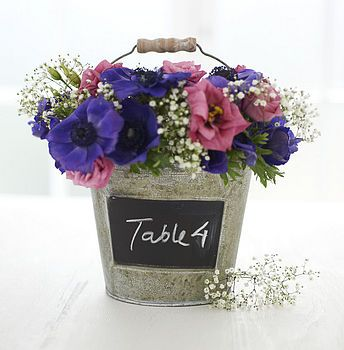 Blackboard on metal buckets for the table numbers