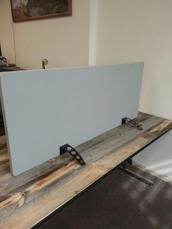 This desk divider is free standing. The sound proof fiberboard material we use is to reduce noise in the work place. It also helps with privacy. We recover the acoustic material in panel fabric. There are different fabric options to work with the color palette of your office. $165 each from Etsy