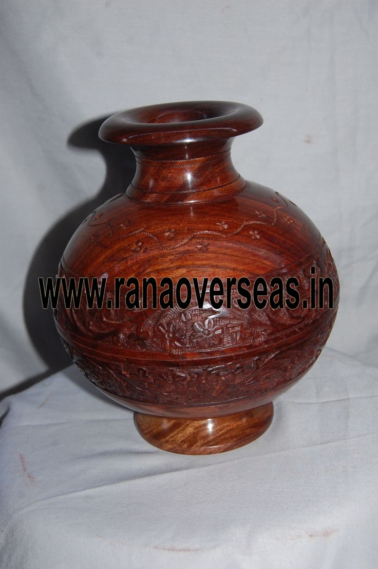 Our Wooden flower vases are serve as a memorable gifts for near and dear ones. They are ideally placed on writing tables, coffee tables, dining tables, center tables, Room corners, corner racks, corner tables, showcases etc. and impart a touch of style to the decor. The exotic beauty of Wooden flower vases gets multiplied by decorating them with fresh flower stems.