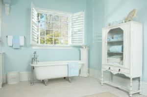 Shabby Chic Bathroom Idea: -This bathroom is the perfect example of a shabby chic inspired room. The soft aqua painted walls with the fresh cottage white are a great cottage color scheme. The vintage furniture and claw foot tub make this a very appealing look for any cottage home.Wall Colors, Bathroom Design, China Cabinets, Clawfoot Tubs, Painting Wall, Bathroom Ideas, Cottages Colors, Shabby Chic Bathroom, Blue Bathroom