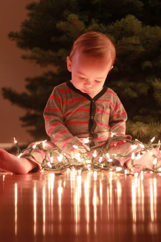 Nice idea for a Christmas photo with small children. The light off the shiny wood floor emits a lovely light to frame the face. How nice to capture those memories of helping out with decorating the tree.