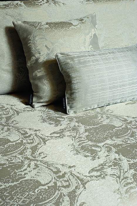 Hermitage - Inspired by Baroque-style architecture, this vertical striped design arises from a robust background of linen and metallic yarns, contrasting with the clean and sleek satin.