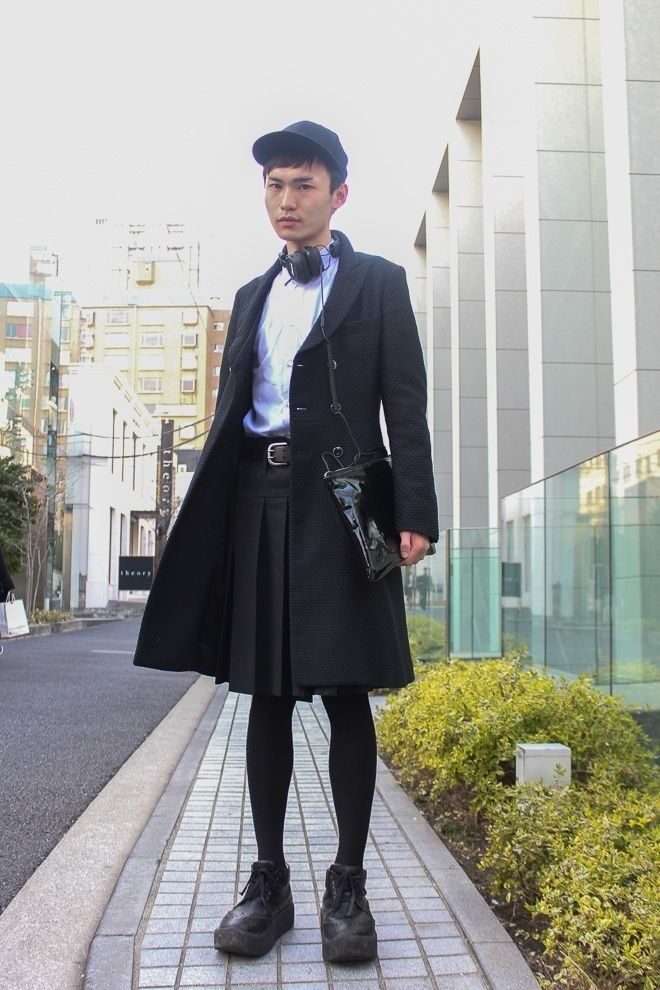 japanese street fashion. men in kilt skirt and pantyhose have a stylish business look