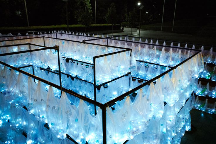 luzinterruptus weaves labyrinth of plastic waste from 6000 illuminated bottles