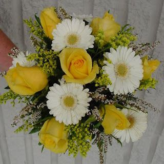 this is kinda what i had in mind for the bridesmaids, but sunflowers and some yellow gerber dasies too.  Bouquet Bridal: Yellow Gerbera Wedding Bouquets