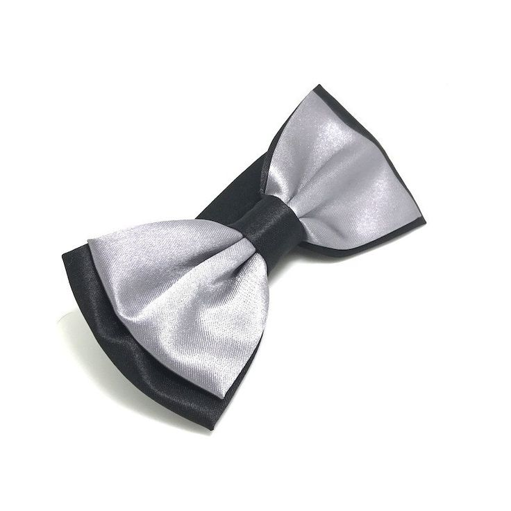 James Bow Tie    Silver bow ties are becoming new to-go accessories! Pair it up with a tuxedo for a classy look or an untucked shirt for a casual look!     Color: Silver satin with black    Measures 13cm(w) by 6cm(h)    Comes with a free elegant giftbox