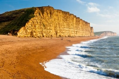 The towering cliffs at West Bay on the Jurassic Coast of Dorset England UK