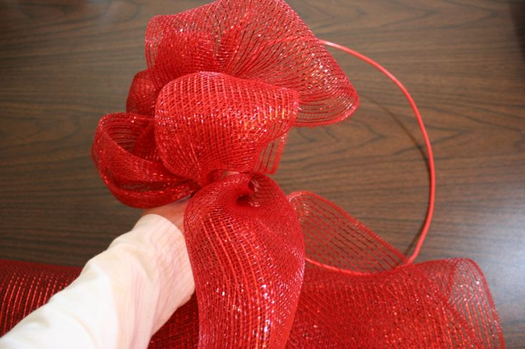 Easy DIY wreath tutorial which uses mesh ribbon, tape, and a wire hanger.  Ready in 15 minutes!
