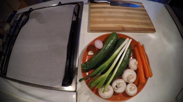 Hi! This is our new video recipe, a really quick and healthy side dish: oven baked mixed vegetables.  Finely chop the vegetables you like and sprinkle with salt and some spices to taste.