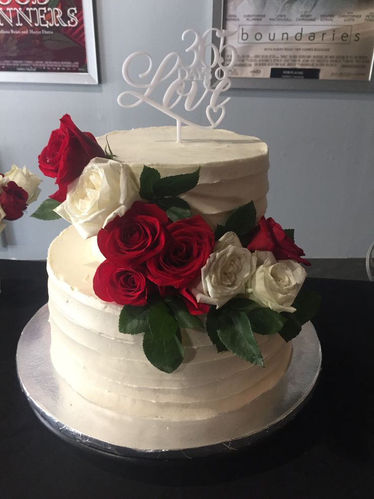 Two tier buttercream and rose first anniversary cake ️
