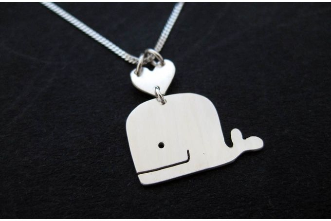 A Whale of a Time. This silver whale pendant is hand cut from sterling silver sheet. The pendant dangles from a dainty sterling silver chain.  For sale on http://hellopretty.co.za