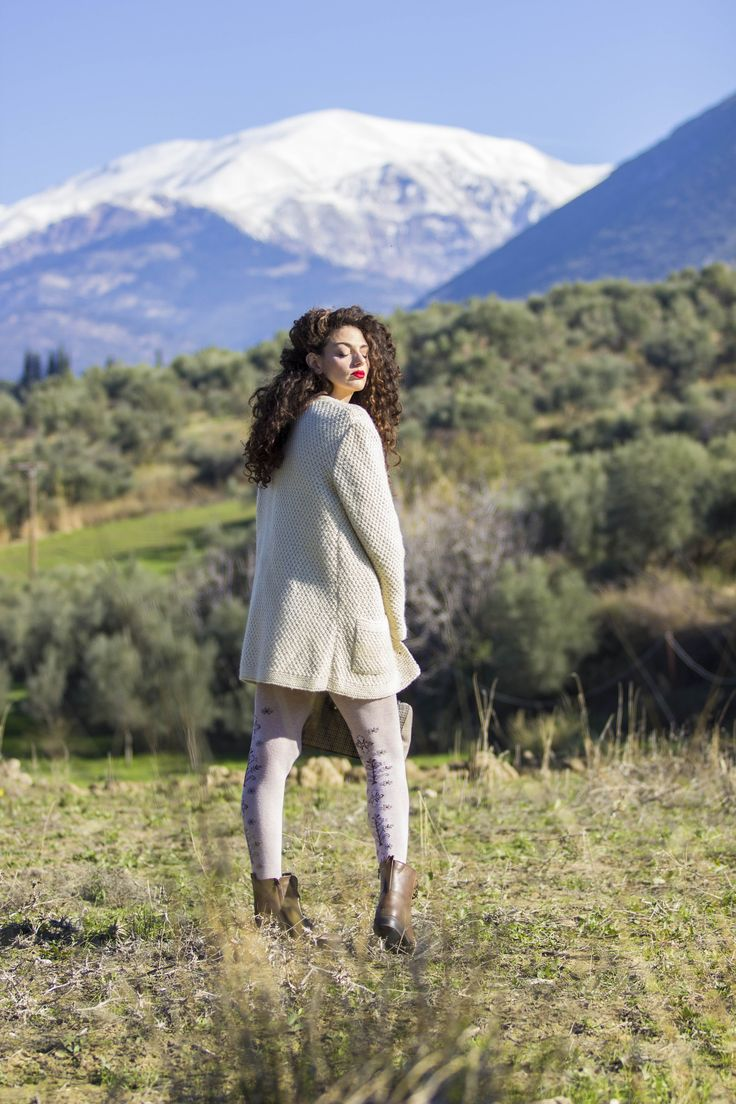 Knitted white cardigan, patterned tights and combat boots
