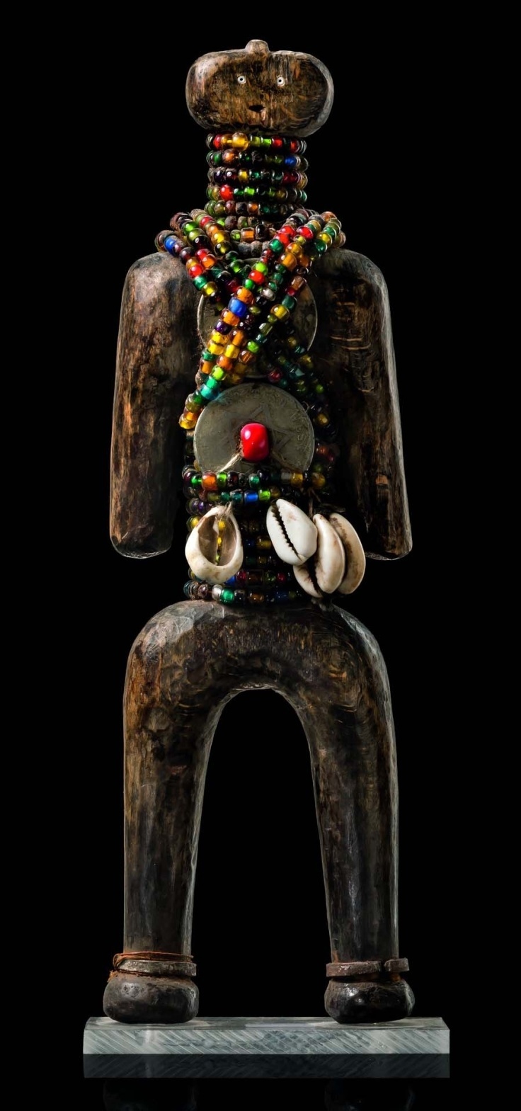 Africa | Fertility doll from the Namchi people of Cameroon | Wood, glass beads, cowrie shells and metal | These maternity dolls are worn on the belly or on the back, by women that are threaten to be sterility. Carved by blacksmiths, these effigies are then decorated by women themselves.