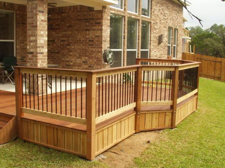 Wood deck railing design ideas see 100s of deck railing for Terrace railing design