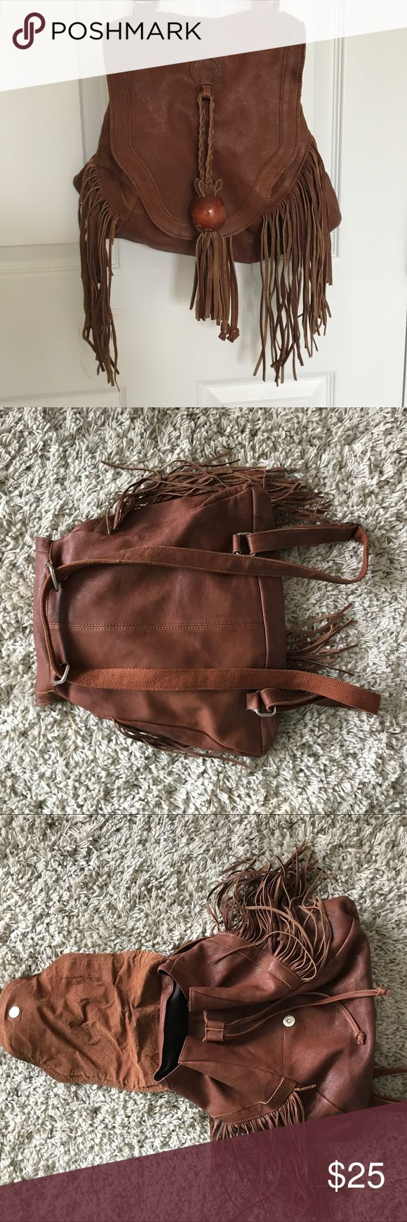 Brown Leather Backpack Brown, fake leather backpack from Urban Outfitters. There is a water mark on the bottom/back but still in good condition. Urban Outfitters Bags Backpacks