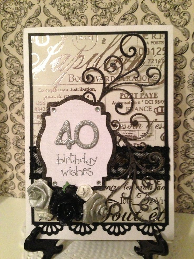 Classic elegance. Black, silver and white. Lace, flowers, black diecut flourishes and bling