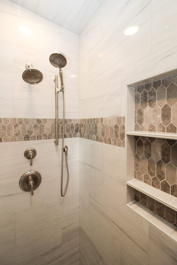 Marble Tiled Shower Walls With Brown Tiled Accent In 2020 Brown Tile Shower Shower Tile Brown Tile Bathroom