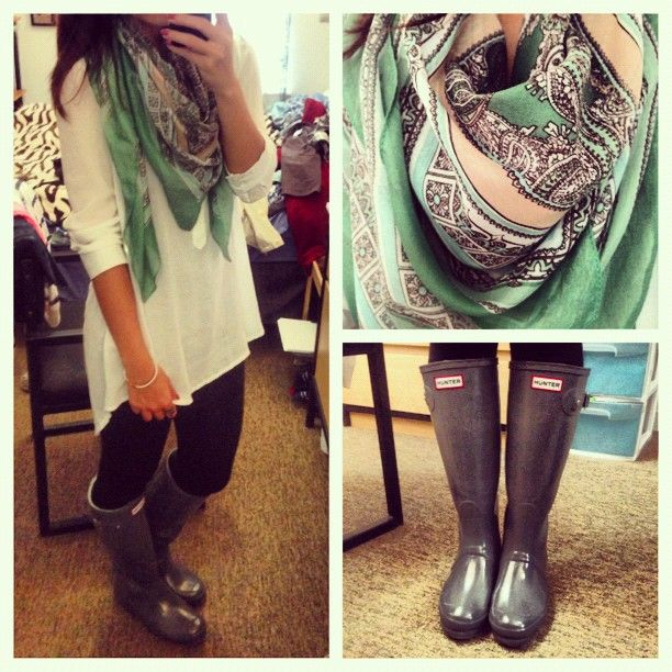 Rainy day outfit: Long cream tunic, black leggings, gray rain boots, colorful scarf