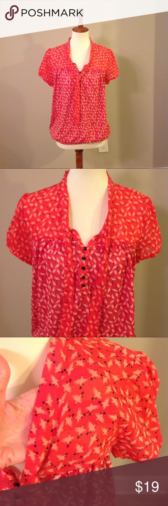 LOFT Red Short Sleeve Top w/Tie This is a cute Loft top with short sleeves and print of small birds. Neckline has small buttons and tie detail. Top section of shirt and sleeves are somewhat see through shown in picture 3. Elastic hem at the bottom. LOFT Tops Blouses