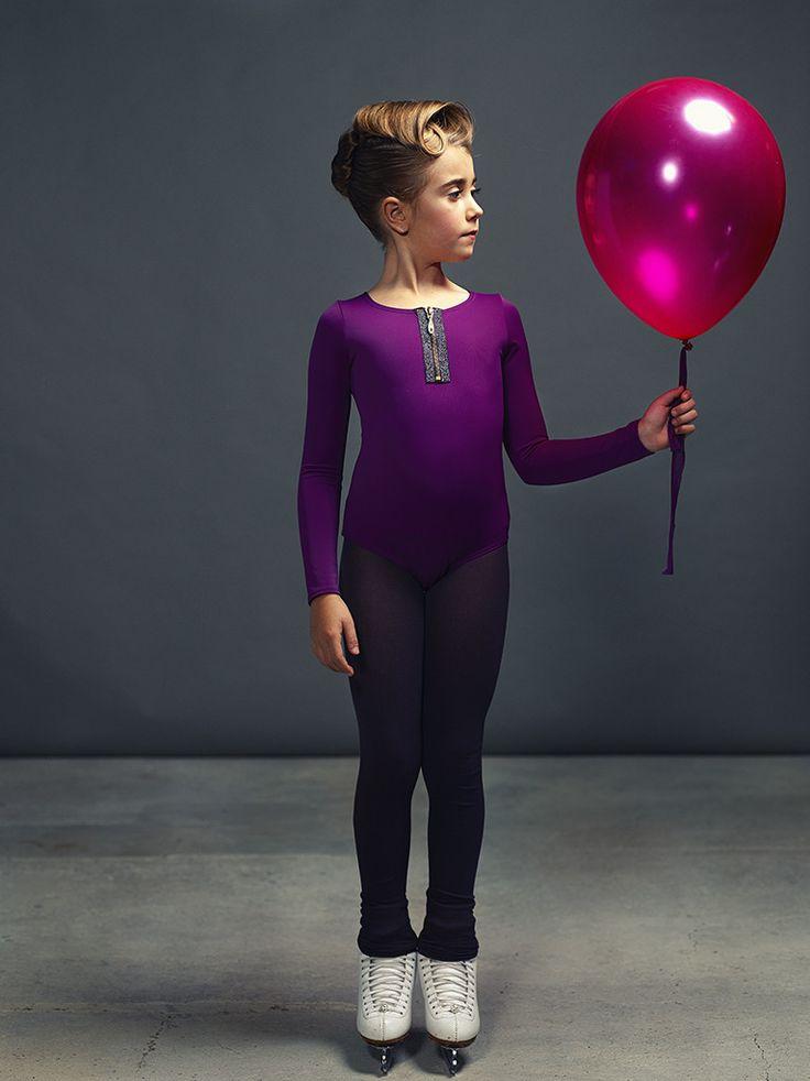 Figure skating or roller, danse and artistic gymnastics bodysuit with removable short elastic skirt and glittered Swarovski stones zipper.
