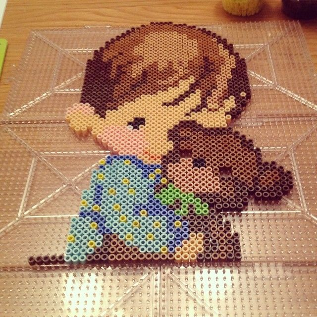 Boy with teddy perler beads by caseymtaft