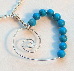 Looks like some pretty simple wire work, but the beads bring a really nice color into it. I like!