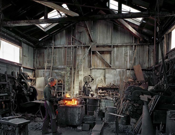 Janet Delaney, Johnny Ryan, Blacksmith, Klockar's Blacksmith and Metal Works, 443 Folsom Street, 1980. Archival pigment print. Image courtesy of the artist. © 2014 Janet Delaney