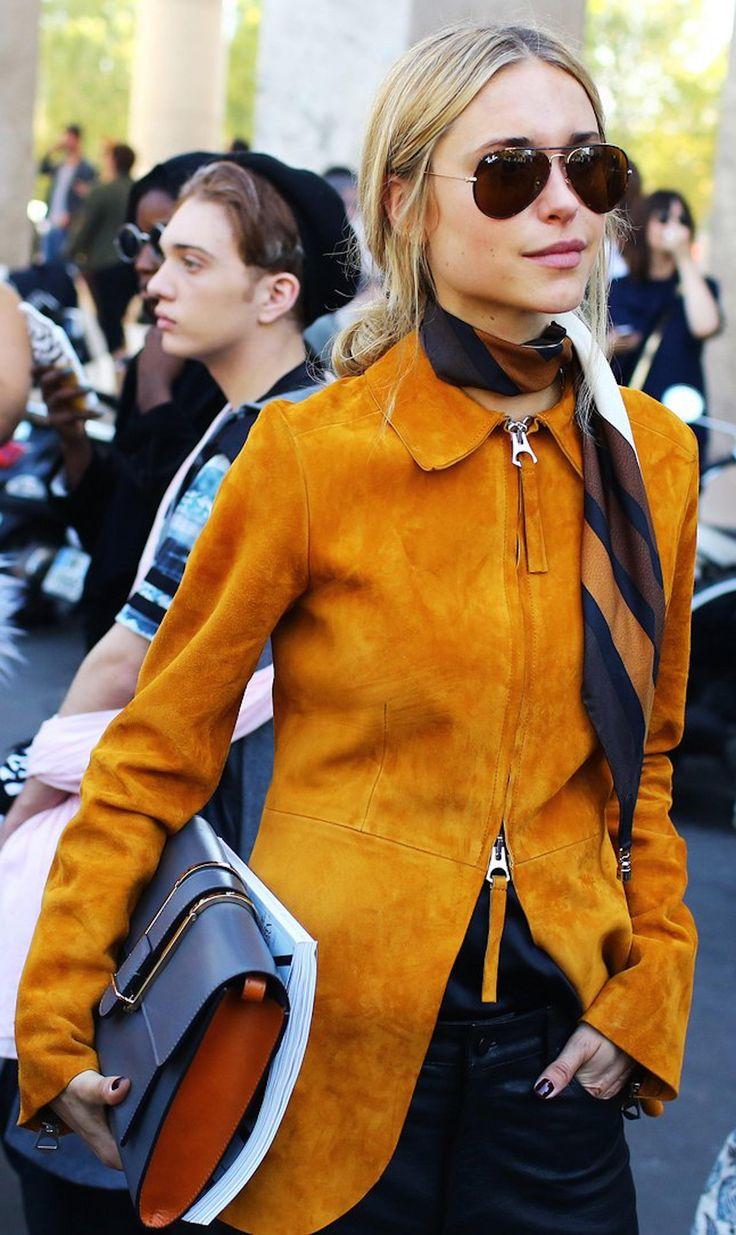 Pernille Teisbaek in a suede orange jacket