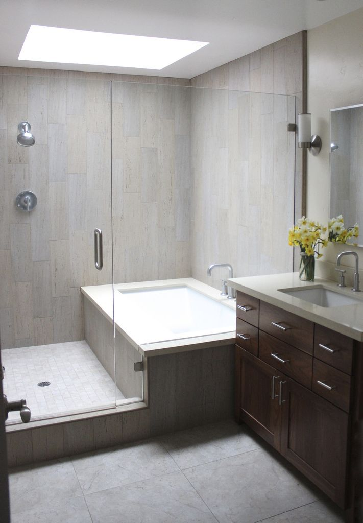 combined bath shower converted into separate ones glassed in together; used wood plank looking tile