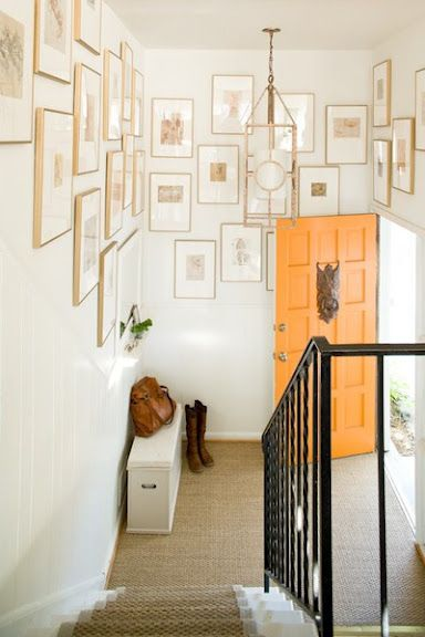 thin gold frames gallery wall, and oh the orange door (change the