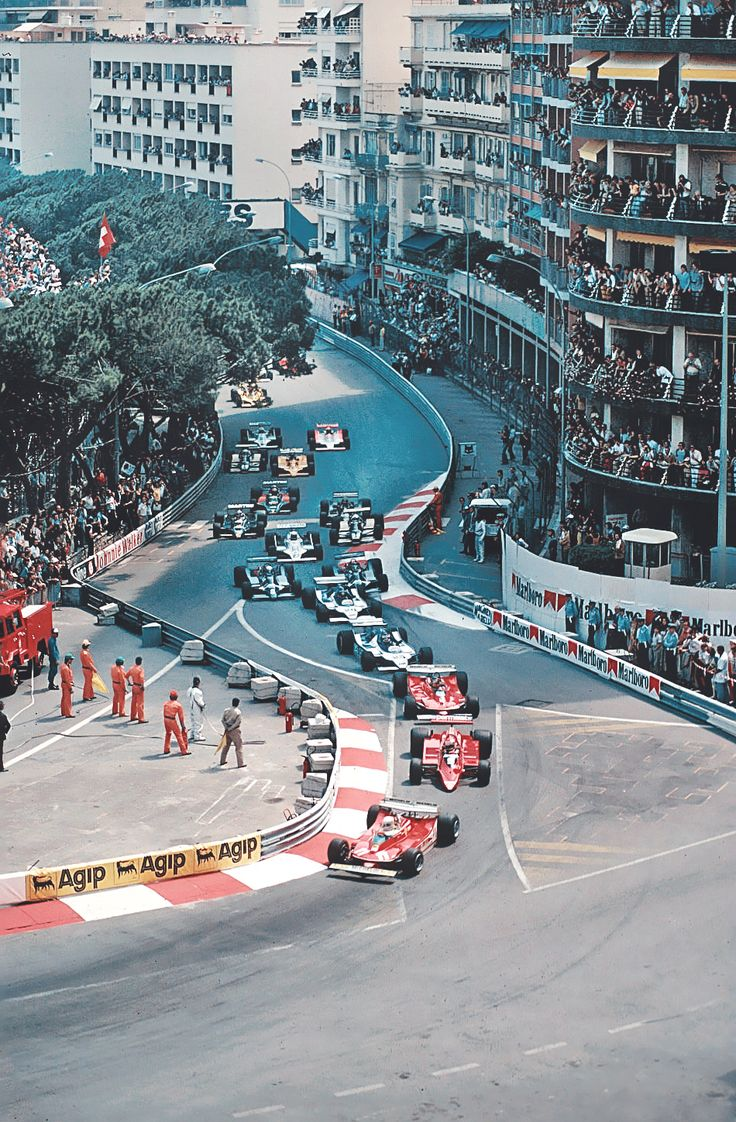 Classic - Monaco Grand Prix start - mid '70s, Jody Scheckter and Gilles Villeneuve in Ferrari's, surround Niki Lauda in an Alfa-Romeo.