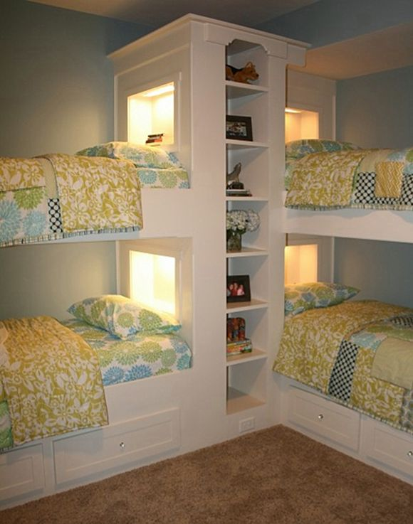 Beach House Bunk Rooms. Great idea for a small space. I like the headboard niches with lights and the shelves... good use of space.