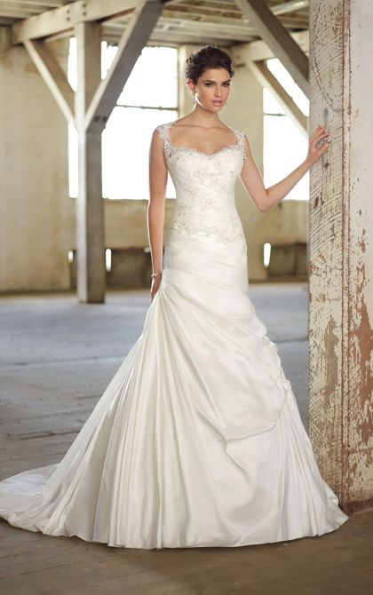 This exquisitely whimsical designer wedding dress comes with a detachable cap sleeve illusion neckline that features scalloped lace details ...