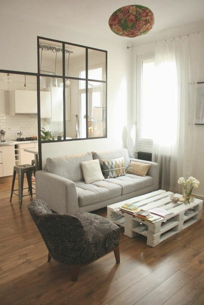 This whole living room set up is what i want. small love seat, chair, coffee table. love the pallet idea.