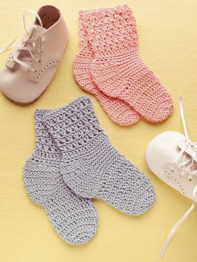 """A Loveable Pair of Baby Socks  Warmth for your favorite pair of feet. Sock size: 3 1/2"""" sole  Designed by Sue Childress  free pdf from free-crochet.com"""