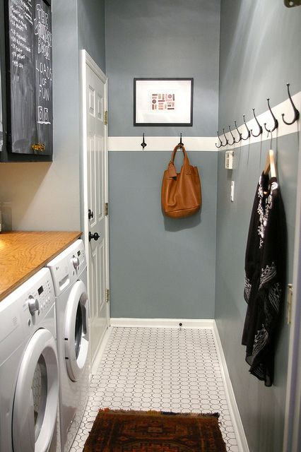 "simple inexpensive very narrow laundry room with what looks like a piece of plywood on top the appliances for a makeshift but workable folding space. love the blackboard paint cupboards...this but with ""cubbies""/bench across from washer and dryer?"