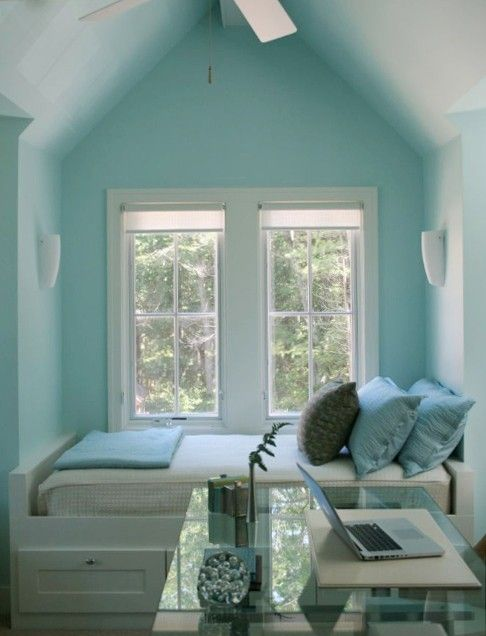 Love the sea glass colors in the little bed nook. Ideal for a small space to fit a guest bed.