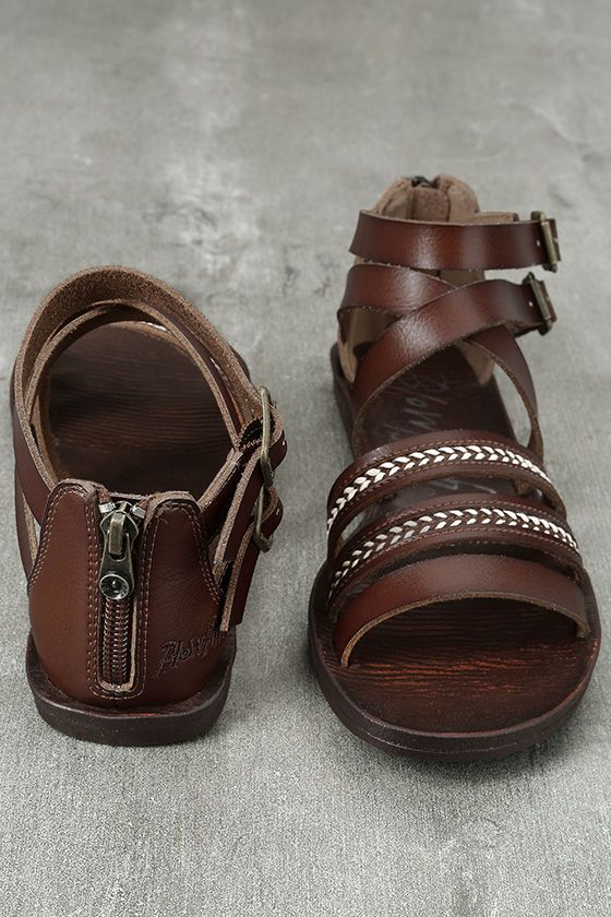 """Whether you venture by land or sea, the Blowfish Dodo Whiskey Brown Gladiator Sandals will be ready! Vegan leather straps, with embroidered accents, climb from a peep-toe upper, to a cute gladiator design with adjustable, antiqued gold buckles at the outstep. 2.5"""" heel zipper."""