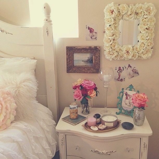 Pretty shabby chic bedroom. Love the floral details and pops of color in turquoise and pink rose.