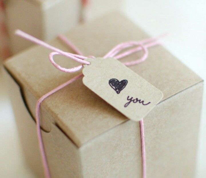 Easy.  Buy unassembled boxes made from recycled cardboard and just tie it with a nice baker's twine with a handmade tag.