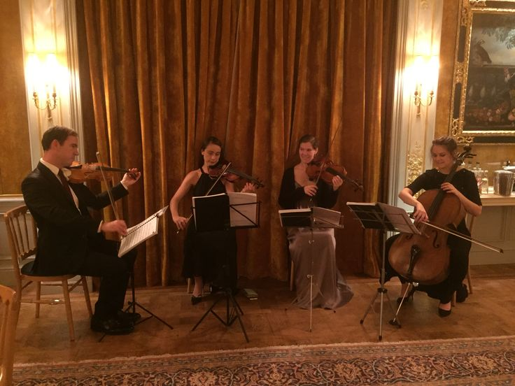 One Of Our String Quartets Playing Live In The Savile Club For Elegant And Refined Wedding Quartet