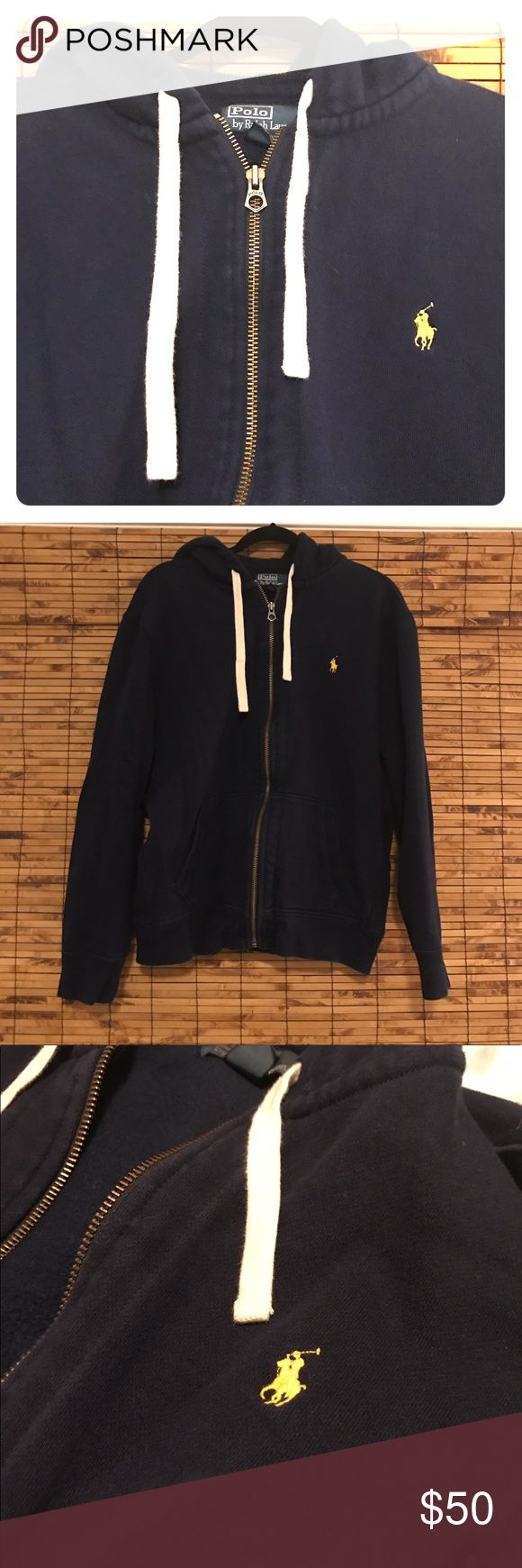 POLO Ralph Lauren navy zip up hoodie Navy zip up hoodie with bright white drawstrings and little yellow polo horse. Almost excellent condition just slight fading to navy color. Tag reads XL but I think it fits more like a L. Polo by Ralph Lauren Shirts Sweatshirts & Hoodies