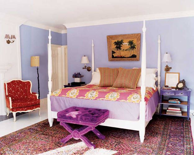 Thanks to various shades of purple and rich texture, the master bedroom of Angela Janklow's Laurel Canyon home exudes style with lavender walls, magenta Osborne & Little upholstery on the bench and a high-gloss bedside table.