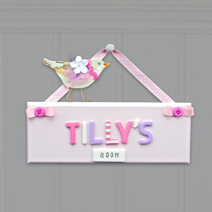 Pink personalised bedroom door sign with bird