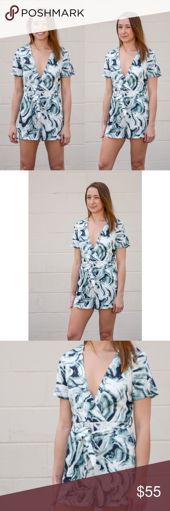 🎉1 HR SALE🎉 Sage Romper Short sleeve surplice front printed self belted romper. Absolutely stunning 😍😍😍 An absolute MUST-HAVE for any fashionista 💁🏻 Soft and comfy!! 100% polyester. No trades. Price firm unless bundled. Kyoot Klothing Pants Jumpsuits & Rompers