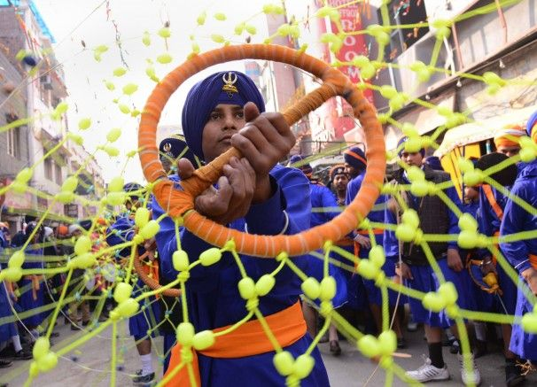 A Sikh Nihang, or warrior, performs Gatka martial arts skills during a procession at the Golden Temple in Amritsar, India, as part of celebrations of the anniversary of the birth of Guru Gobind Singh, the tenth Sikh guru.